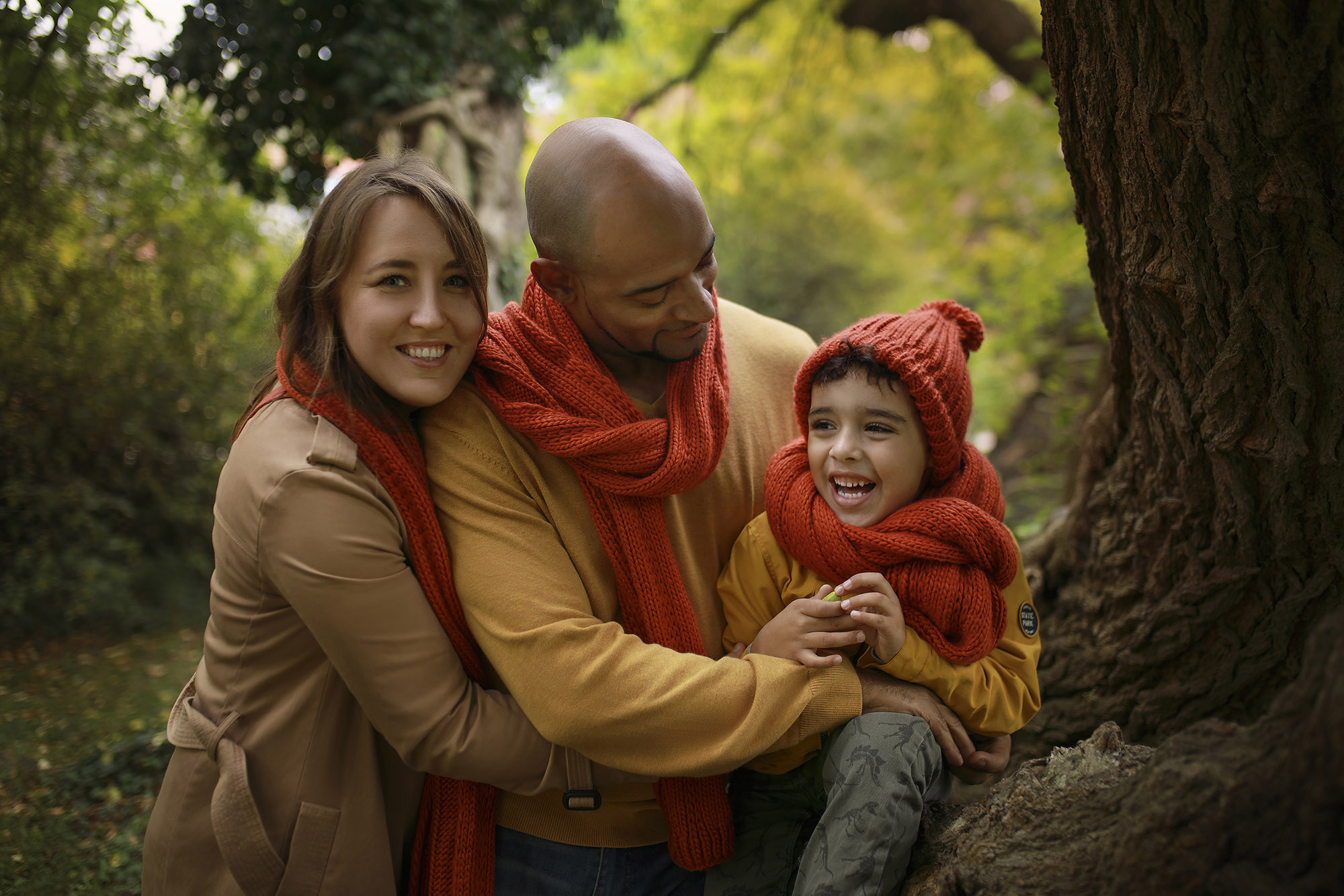 Family in forest wearing a red scarf