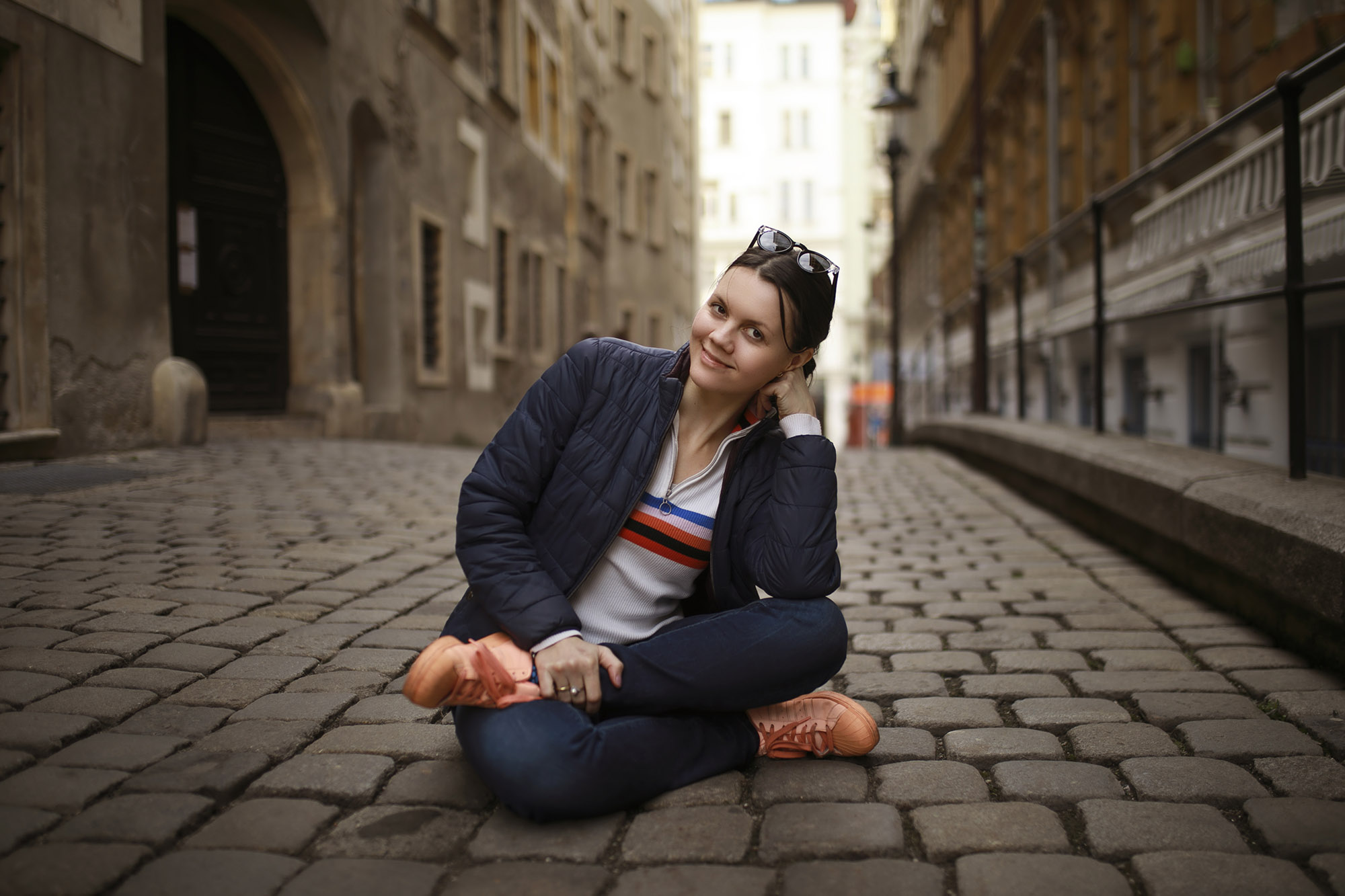 Woman sitting on paving stones in Vienna
