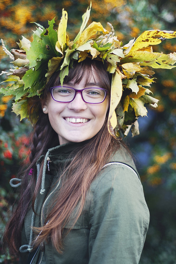 Smiling teenage girl with leaf wreath on her head