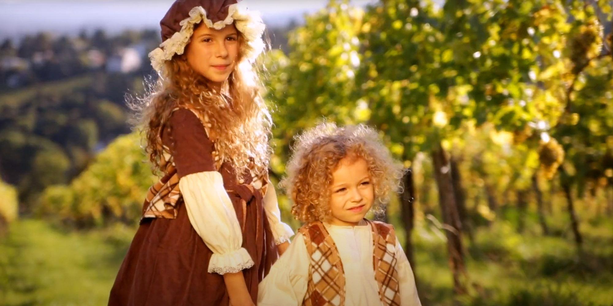 Two kids in vineyard